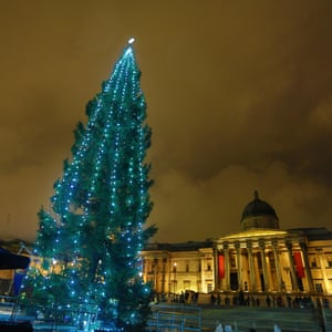 The traditional Christmas tree, a gift from the people of Norway, stands in Trafalgar Square, London.