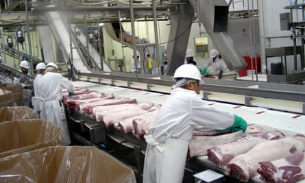 Workers process pork at a hi-tech plant in Illinois.