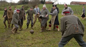 Ploegsteert, Belgium Re-enactors dressed in First World War British and German uniforms kick around a football during a re-enactment of the 1914 Christmas Truce