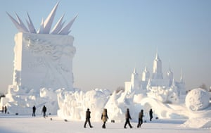 Harbin, China Workers put the finishing touches to snow sculptures at an expo