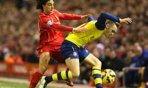 Lazar Markovic of Liverpool challenges Calum Chambers of Arsenal.
