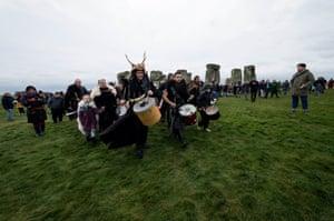 Drummers walk around the site