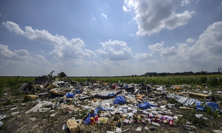 Wreckage and personal possessions at the site where Malaysia Airlines flight MH17 crashed in Ukraine.