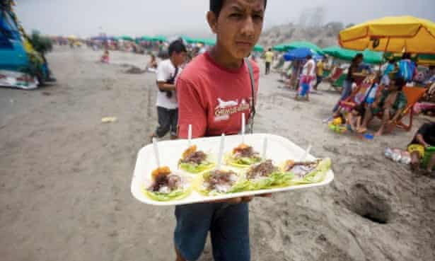 A boy sells servings of ceviche at Agua Dulce beach in Lima.