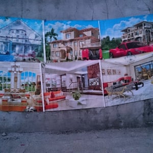 West Point Dreams. Posters of tastelessly opulent houses at the entrance of #Monrovia's largest slum West Point. #Liberia
