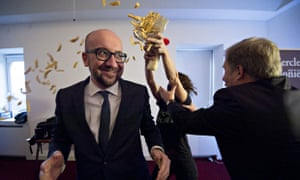 Activists throw fries and mayonnaise over the Belgian prime minister, Charles Michel, in a protest b