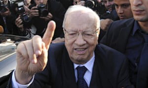 Beji Caid Essebsi leaves the polling station of Soukra after casting his vote