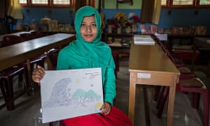 pupil at a school in Banda Aceh shows her drawing of the Boxing Day tsunami