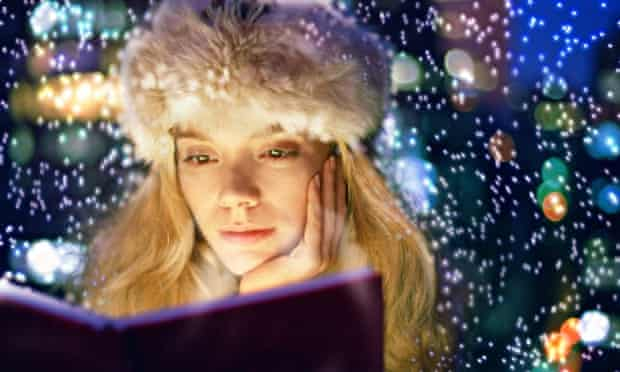 woman reading winter lights