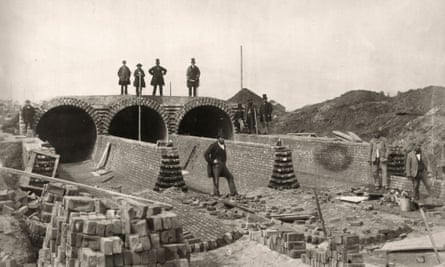 Sir Joseph Bazalgette, standing top right, views the Northern Outfall sewer being built in Stratford, London, in 1862.