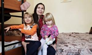 Ukrainian businesswoman Oksana Kolyada, 35, with the daughters