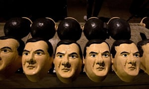 Rubber masks of chancellor George Osborne are lined up amid anti-austerity protesters.