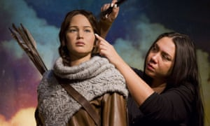 Hair stylist Gemma Sim poses putting the finishing touches J-Law's statue.