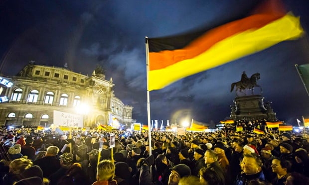 Participants hold German national flags