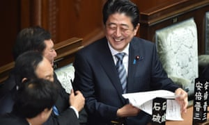 Smiles all round. Shinzo Abe in Parliament on Wednesday, shortly before being re-elected prime minister.