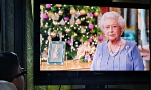A boy watches the Queen's Christmas Day speech