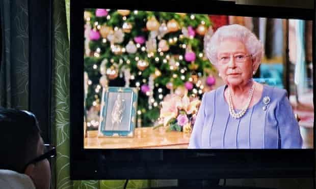 A boy watches the Queen's Christmas Day speech