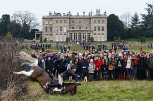Spectators watch a member of the Quorn Hunt fall from their mount during the traditional Boxing Day meet at Prestwold Hall, Loughborough
