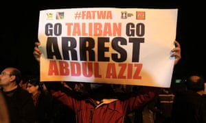 A man holds a sign during a protest near the Red Mosque in Islamabad last week.