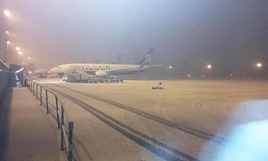 Snow at Liverpool's John Lennon airport, which was closed while runways were cleared.