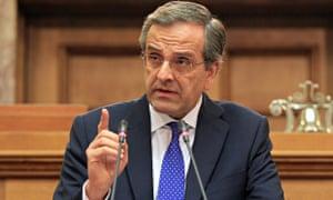 Greek Prime Minister Antonis Samaras addresses MPs of his party