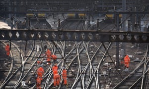 Railway workers on the tracks outside King's Cross, London, as trains in and out of the station have been cancelled.