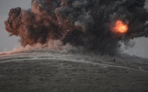 Islamic State militants were being photographed the moment an air strike explosion goes off on 23 October 2014