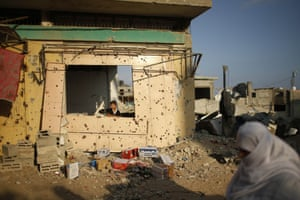 A Palestinian boy looks out from his family's damaged house in Gaza on 12 October 2014