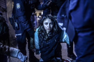 A young girl is pictured after she was wounded during clashes between riot police and prostestors after the funeral of Berkin Elvan in Istanbul on 12 March 2014.