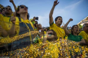 Brazilian fans celebrate during the opening match of the World Cup between Brazil and Croatia in Sao Paulo on 12 June 2014.