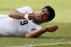 Uruguay's Luis Suarez reacts after clashing with Italy's Giorgio Chiellini during the World Cup match in Natal on 24 June 2014.