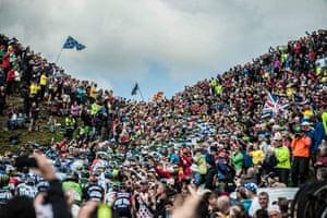 The main peloton rides towards the amphitheatre of Buttertubs Pass as the Tour de France's Départ got underway in Yorkshire.