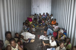 People flee Bangui for Cameroon in a container on February 22, 2014.