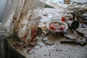 Damaged goods lie in a shelled kitchen in Donetsk, Ukraine, on 26 August 2014.