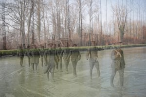 In a project to mark the centenary of the start of the first world war, photographer Peter Macdiarmid matched photographs of significant events of the first world war with images of the same locations today. In this final photograph, a Royal Garrison Artillery working party carry duck-boards across the frozen Somme canal at Frise in March 1917, France. Outlines of trenches can still be seen today in the village of Frise. Click here to see more from the centenary project