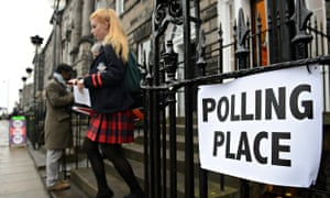 A young voter leaves a polling station in the Scottish independence referendum
