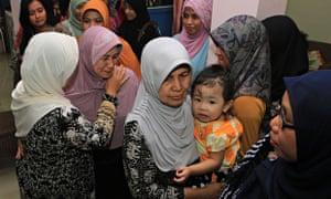 AirAsia flight QZ8501 relatives of flight attendant