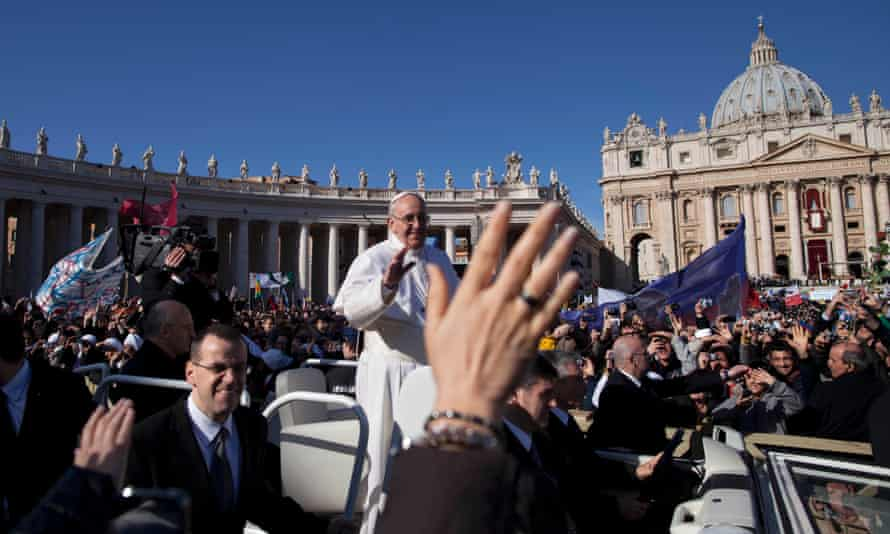 Pope Francis waves to crowds as he arrives on his popemobile for his inauguration Mass in St. Peter's Square at the Vatican, Tuesday, March 19, 2013. Pope Francis urged princes, presidents, sheiks and thousands of ordinary people gathered for his installation Mass on Tuesday to protect the environment.  He's expected to speak in support of a strong international climate agreement in 2015.