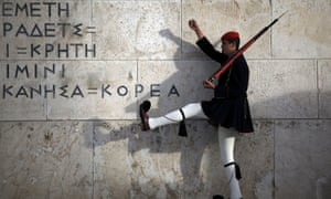 A Greek presidential guard performs a ceremonial march at the monument of the unknown soldier in front of the parliament building in Athens on Saturday.