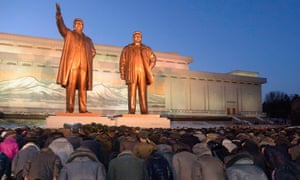 North Koreans bow to bronze statues of North Korea's late founder Kim Il-sung and late leader Kim Jong-il at Mansudae in Pyongyang in December 2014.
