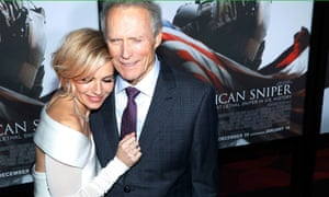 Sienna Miller is embraced by Clint Eastwood at the premiere of American Sniper