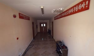 """Signs in a labour camp used by North Korean workers in Qatar read, """"Let us arm ourselves with the revolutionary ideals of our great Kim Il-Sung and Kim Jung-Il"""" and, """"Our great Kim Il-Sung and Kim Jung-Il are with us forever"""""""