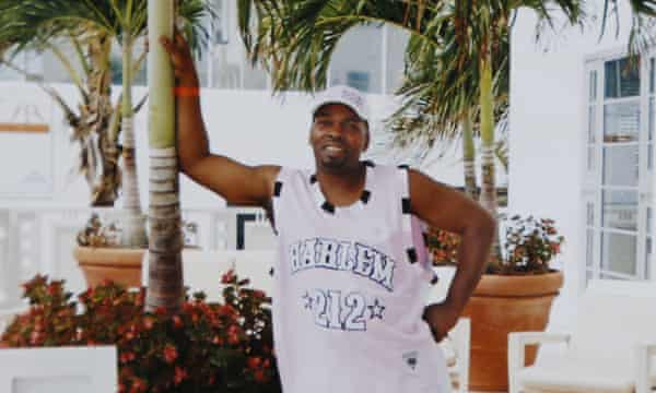 In this 2004 photo provided by Terri Scroggins, Victor Woods poses in Miami.