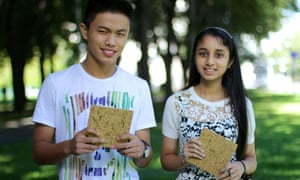 Rayvin Thingnam and Bisman Deu holding Green Wood. Made from unwanted rice waste, it can serve as a building material for low-cost housing.