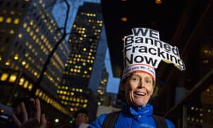 woman with 'we banned fracking sign'