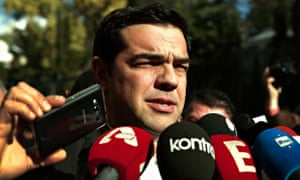 Syriza leader Alexis Tsipras talks to reporters outside the Athens parliament after the last round o