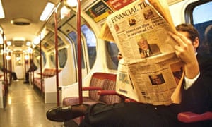 FTSE Man reading Financial Times on tube