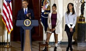 Malia, right, and Sasha Obama , centre, at the  presidential turkey pardon ceremony.