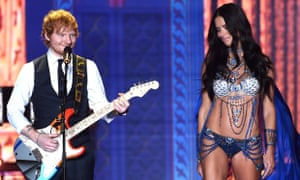 Strict embargo, not to be used before 21:00 GMT 02 Dec 2014 - Editorial Use Only, No Merchandising Mandatory Credit: Photo by David Fisher/REX (4273353bo) Ed Sheeran performing with Adriana Lima on the catwalk Victoria's Secret Fashion Show, London, Britain - 02 Dec 2014 plg