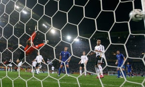 German goalkeeper Jens Lehmann dives in vain to save athe shot from Fabio Grosso.